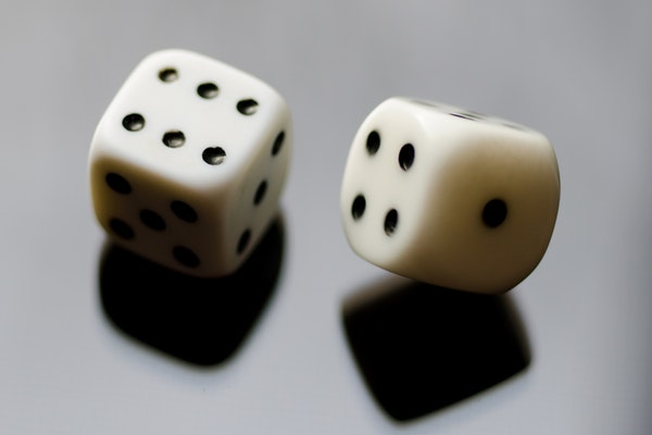 Two dice in motion on a sheer surface