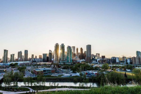 Calgary cityscape against blue-white sky