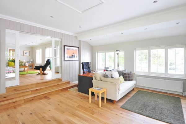 Living room with wood flooring and white walls